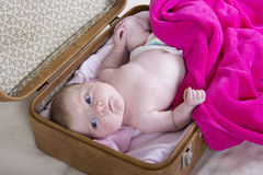 Little girl in suitcase. One month baby girl in a vintage suitcase Royalty Free Stock Images