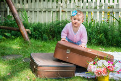 Little girl on suitcase Royalty Free Stock Photos