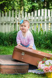 Little girl on suitcase Royalty Free Stock Photo