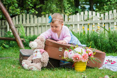 Little girl on suitcase Royalty Free Stock Photography
