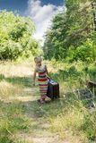 Little girl with a suitcase at the railway Royalty Free Stock Photo