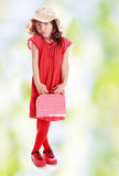 Little girl with a suitcase Royalty Free Stock Photography