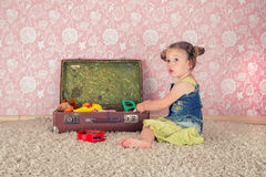 Little girl with suitcase stock photography