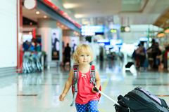 Little girl with suitcase travel in the airport Royalty Free Stock Photo