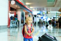 Little girl with suitcase travel in the airport Royalty Free Stock Photos
