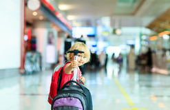 Little girl with suitcase travel in the airport Royalty Free Stock Photography
