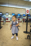 Little girl with suitcase travel in the airport Royalty Free Stock Image