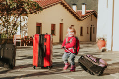 Little girl with suitcases travel in Europe Stock Images
