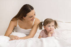 Little girl sulking  with her mother Royalty Free Stock Image