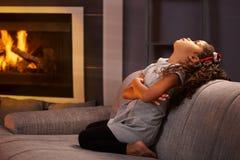 Little girl sulking on sofa Stock Photos