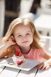 The little girl in a summer cafe Stock Photography