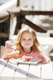 The little girl in a summer cafe Royalty Free Stock Photo