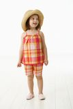 Little girl in summer dress Stock Images