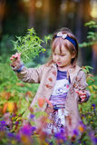 Little girl in summer forest Stock Photo
