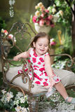 Little girl in summer garden. Playing with soap bu Royalty Free Stock Image