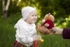 Little girl summer happy Teddy bear Stock Photography