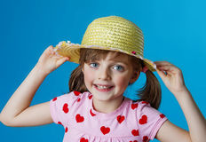 Little girl with a summer hat Stock Photo