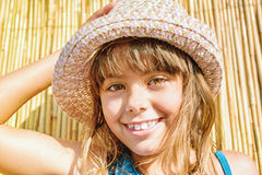 Little girl with the summer hat Stock Image