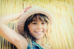 Little girl with the summer hat in a faded look Royalty Free Stock Photos