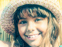 little girl with the summer hat in a faded look Stock Photos