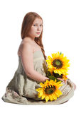 Little girl with summer hat and sunflowers Royalty Free Stock Photos