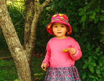 little girl in a summer hat for a walk Royalty Free Stock Image