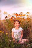 Little girl  on summer meadow. royalty free stock photo