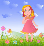Little girl on summer meadow Stock Photography
