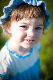 A little girl in a summer park Royalty Free Stock Image