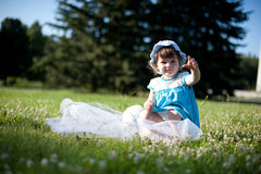 A little girl in a summer park Royalty Free Stock Photo