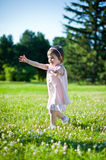 A little girl in a summer park Stock Image