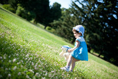 A little girl in a summer park Royalty Free Stock Photos