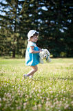 A little girl in a summer park Stock Images