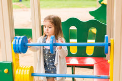 Little girl on the summer playground Royalty Free Stock Images