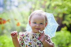 Little girl with sun umbrella Stock Photos