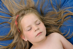 Little girl sunbathing Stock Photography