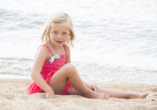 Little Girl Sunbathing on the Beach Stock Photography