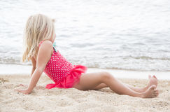 Little Girl Sunbathing on the Beach Stock Image