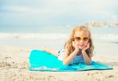 Little girl sunbathing. Royalty Free Stock Image