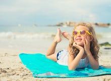 Little girl sunbathing. Stock Images