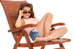 Little girl on a sunbed Royalty Free Stock Images