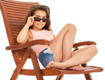 Little girl on a sunbed Stock Photography
