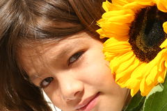 Little Girl and Sunflower Royalty Free Stock Photography