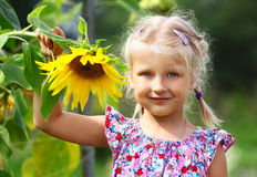 Little girl and sunflower Royalty Free Stock Photo