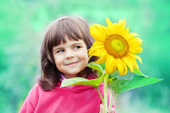 Little girl with sunflower Stock Photos