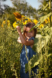 Little girl and sunflowers Royalty Free Stock Photos