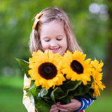 Little girl with sunflowers Royalty Free Stock Photography