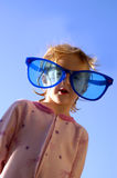 Little Girl Sunglasses. Little girl wearing goofy sunglasses Royalty Free Stock Photo