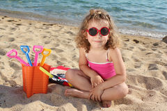 Little girl with sunglasses Stock Photo