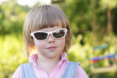 Little girl with sunglasses Royalty Free Stock Photography